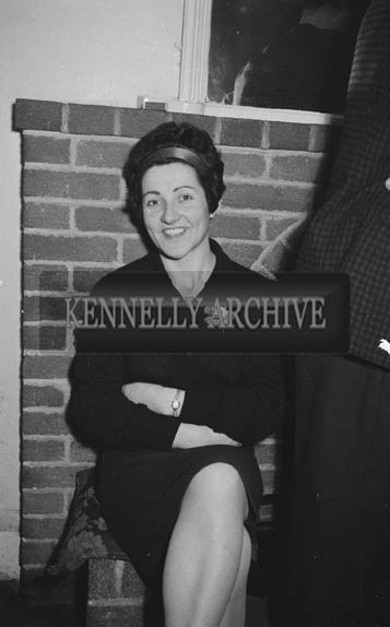 16th January 1964; A woman smiles for the camera at the Lixnaw Social in the Meadowlands Hotel, Tralee.