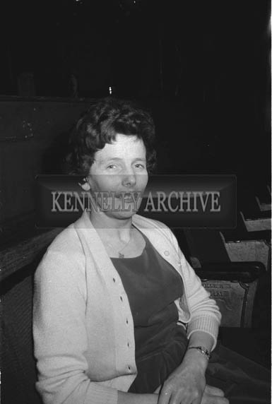 17th January 1964; A woman smiles for the camera at a dance in the Ashe Hall in Tralee. Music at the dance was provided by the Donie Collins Band.