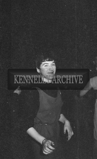 31st January 1964; A photo of a woman at a dance in the Ashe Hall, Tralee.