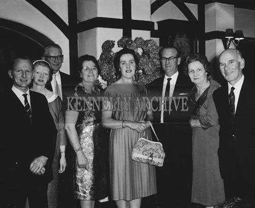 November 1964; People enjoying themselves at the Festival of Kerry Dinner in Benner's Hotel, Tralee. Emmett and Aileen Kennelly are at the left of the photo. Nancy Caball and Mrs. Norrie Laide are fourth and fifth from the left respectively.