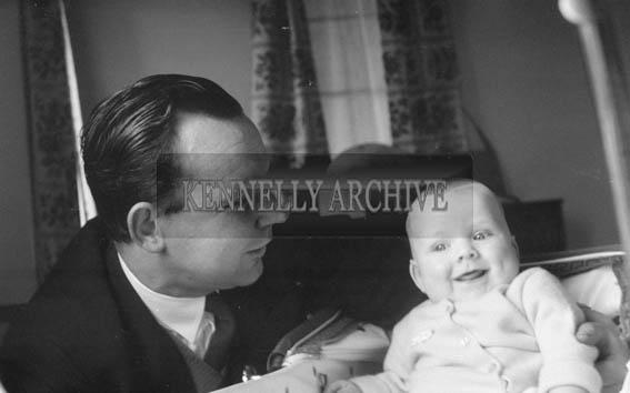 November 1964; A studio photo of Joe Treacy St Brendan's Park, Tralee, with his son Mark.