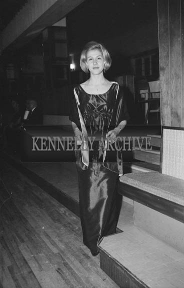 24th November 1964; A woman poses for the camera at the Kerry Bankers Dress Dance in the White Sands Hotel, Ballyheigue. Music was by the Troubadours Dance Band, Tralee.
