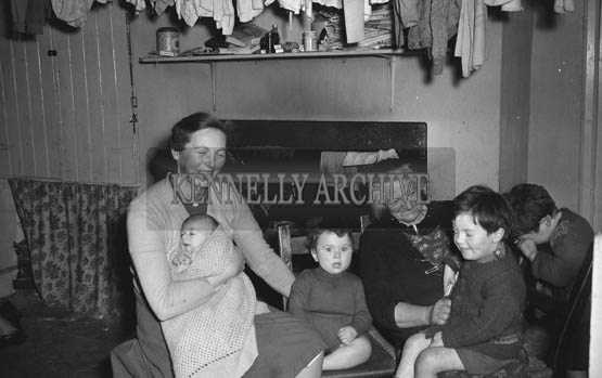 January 1964; A photo of a family at home.