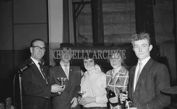 February 1964; A photo of a prize presentation.