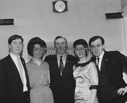 25th November 1964; A group of people pose for a photo at the Ballymacelligott GAA Social in the Hotel Manhattan, Tralee.