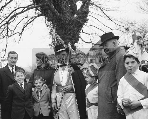 February 1964; A photo of Jimmy Hennessy, the King of the Wrenboys, with members of the Listowel Carnival Committee before his visit to London as a guest of honour at the Wrenboy Dances.