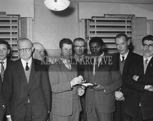 February 1964; Town Clerk Sean Howlett (fourth from left) makes a presentation to Sam Mumba, from Rhodesia, in Tralee UDC Offices. Mr Mumba was in Tralee to carry out a work study. Included in the photo are Mr O'Keeffe (second from left), Town Engineer Ned Fitzmaurice (centre) and Micheal O'Regan (right).