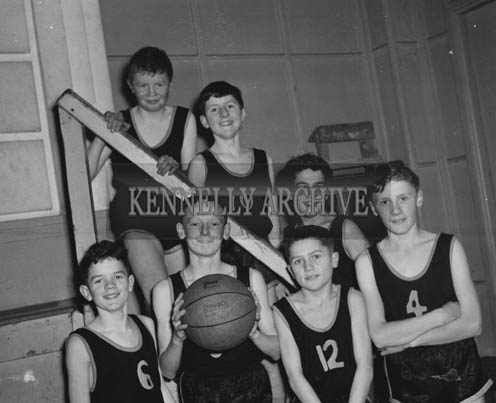 16th February 1964; L. Collin's Team, who won the Rock Juvenile Basketball League in the CYMS Tralee. Clockwise from left back: M. Switzer, L. Collins, Jackie Power, T. Sheehan, Ger Power, G. Dennehy and T. Revington.