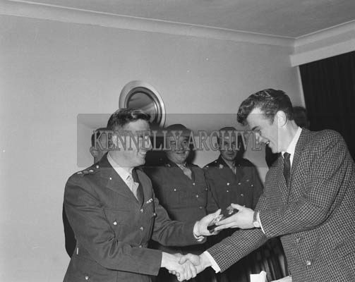 24th February 1964; A photo of a FCA Recruit Bruddy Burrows receiving a medal for shooting.
