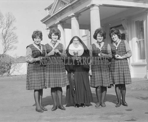 13th March 1964; Students at Colaiste Ide Dingle, who won the Munster debating Cup with a nun.