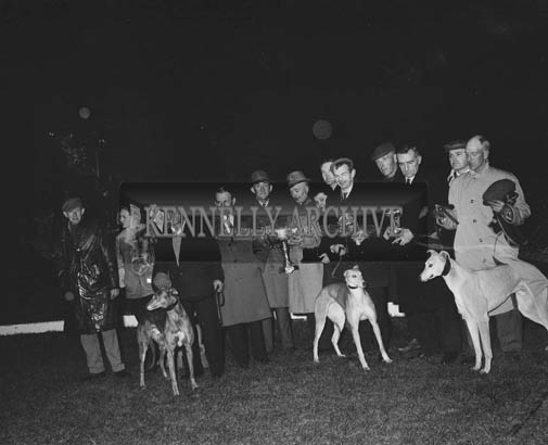 13th March 1964; Three Kerry Greyhounds who won trophies at the Irish Cup meeting in Clounanna being paraded at Tralee Track. From left: Mr. J. Brosnan, Mrs. D. O'Brien, Mrs. M. Crean, Mr. T. Thornton holding 'Spring Twilight', winner of the Irish Cup; Mr. J. O'Donnell, Mr. J.J. Kennelly, Mr. P. O'Sullivan, owner of 'Spring Twilight'; Mr. K. Laide (Racing Manager), V. O'Sullivan, Mr. N. Browne holding 'Fourth Pigeon', winner of the Limerick Stake; J.J. Kennelly, D. O'Brien, J. Lawlor and J. O'Donoghue holding his wife's dog 'Humble Master,' winner of the Irish Purse.