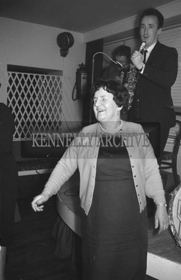 5th December 1964; A woman at the Kevin Barry Social in the Meadowlands Hotel, Tralee.