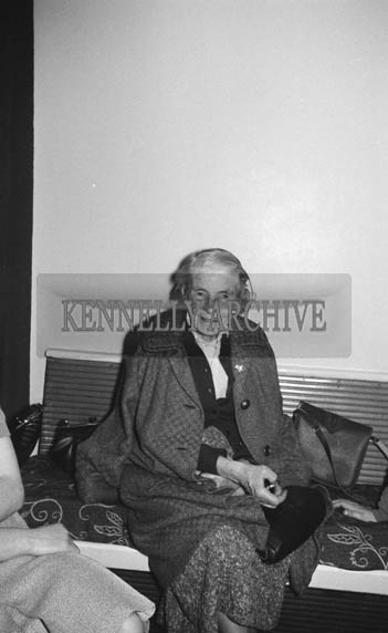 5th December 1964; A woman smiles for the camera at the Kevin Barry Social in the Meadowlands Hotel, Tralee.