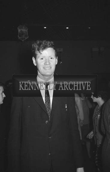 6th December 1964; A man smiles for the camera at a dance in Ballymacelligott.