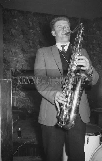 13th December 1964; A musician performs onstage at the John Mitchels GAA Club Social in the Hotel Manhattan, Tralee.