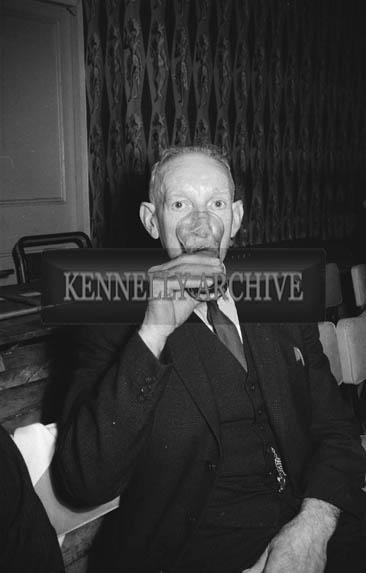 13th December 1964; A man enjoys himself at the John Mitchels GAA Club Social in the Hotel Manhattan, Tralee.