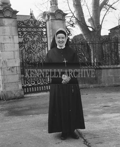 March 1964; A photo of Sister St. Anne from South Africa in front of St. John's Church of Ireland in Ashe Street, Tralee.