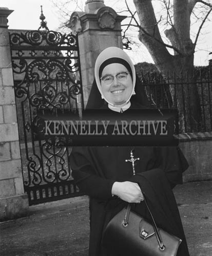 March 1964; A photo of Sister Brendan from South Africa in front of St. John's Church of Ireland in Ashe Street, Tralee.