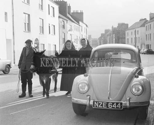 March 1964; A photo of nuns from South Africa visiting Ashe Street in Tralee with a man and a donkey and car. Sister St. Anne is on the left and Sister Brendan is on the right.