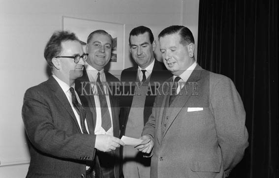 2nd December 1964; Mr. Brennan Byrne, Advertisng & Sales Promotions Manager, Beamish & Crawford Ltd., Cork, presents a cheque to Roger Harty a director of Ballybeggan Park Co. and Chairman of Kerry Coursing Club at a press conference in Tralee. Also present were Brendan Halnan, District Manager, Beamish & Crawford (2nd from left), and Joe Grace.