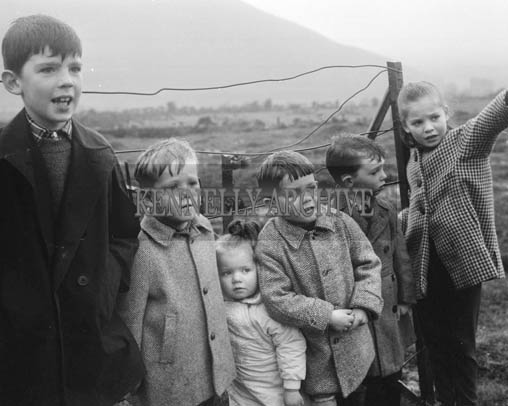 5th December 1964; A photo of Padraig Kennelly Junior and Jerry Kennelly with the Evans children at a beagling weekend in Glenbeigh.