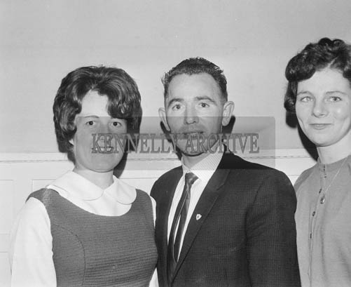 13th December 1964; A group of people pose for the camera at the John Mitchels GAA Club Social in the Hotel Manhattan, Tralee.