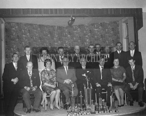 13th December 1964; A group photo taken at the John Mitchels GAA Club Social in the Hotel Manhattan, Tralee.