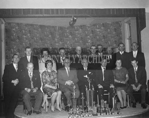 13th December 1964; A group photo taken at the John Mitchels GAA Club Social in the Hotel Manhattan, Tralee.