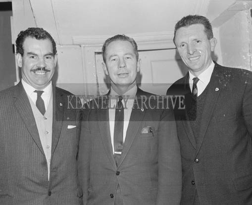 December 1964; Oliver Browne (centre) and Liam Brassil (right) at a presentaion in Tralee Desmonds Boxxing Club.