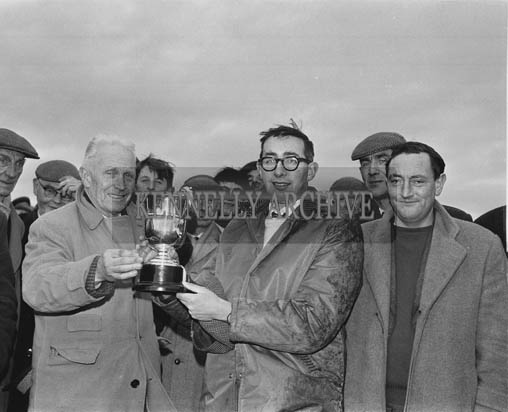 Tuesday 15th December 1964; Mr. Timothy O'Carroll, Vice-President of Lixnaw Coursing Club, presents the Lixnaw Cup to Tralee bookmaker Tunney Galvin after his nomination, 'Biddy Goggin', won the Trophy.