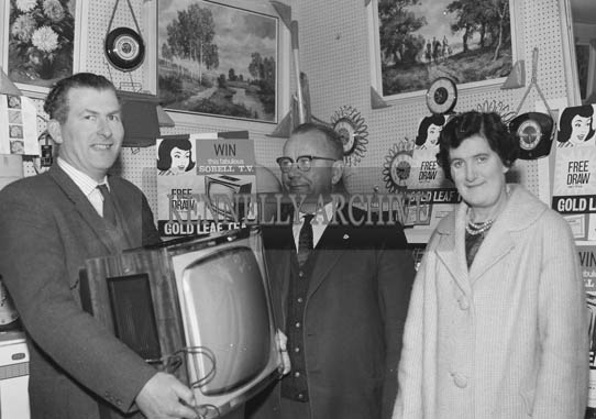March 1964; A photo of the Gold Leaf Tea Free Draw in Clifford's Shop, Tralee.