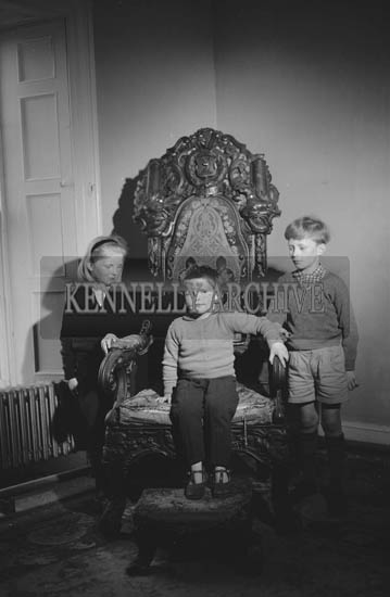 May 1964; A photo of Daniel O'Connell (centre), great, great, great grandson of Daniel O'Connell 'The Liberator', in the wishing chair with two other children at Derrynane.