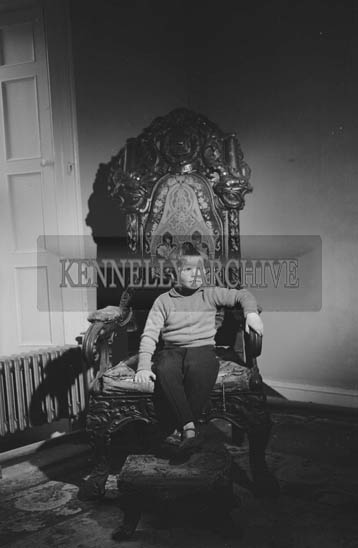May 1964; A photo of Daniel O'Connell, great, great, great grandson of Daniel O'Connell 'The Liberator', in the wishing chair at Derrynane.