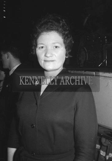 21st December 1964; A woman poses for the camera at a dance in the Ashe Hall, Tralee.