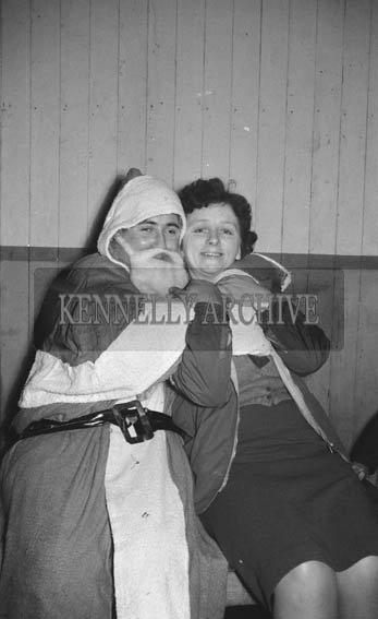 December 1964: A photo of Santa with Dancing Teacher Eileen Laide.