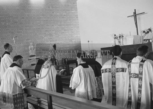 21st April 1964; A photo taken at the opening and blessing of the Corpus Christi Church in Knockanure.  The Blessing was performed by the Rev. Patrick Ahern C.C. Tralee (Celebrant), Rev. Austin O'Callaghan C.C. Beaufort (Deacon) and Rev. Micheal Leahy C.C. Killarney (Sub-Deacon). The church was designed by architect Michael Scott.