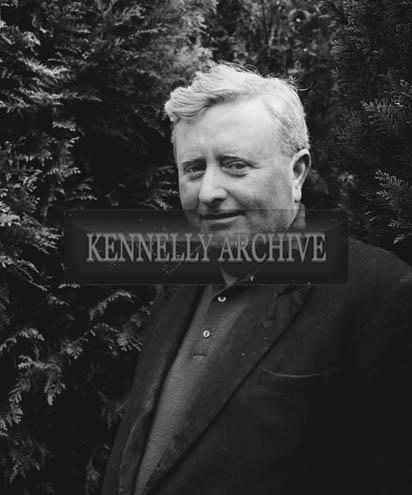 April 1964; A photo of a man taken at a pheasant hatchery.