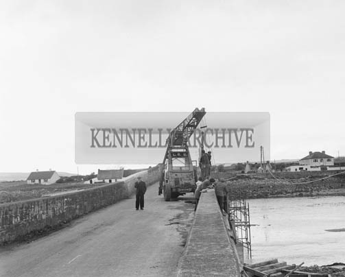 28th April 1964; A photo of water scheme pipes across Blennerville Bridge.