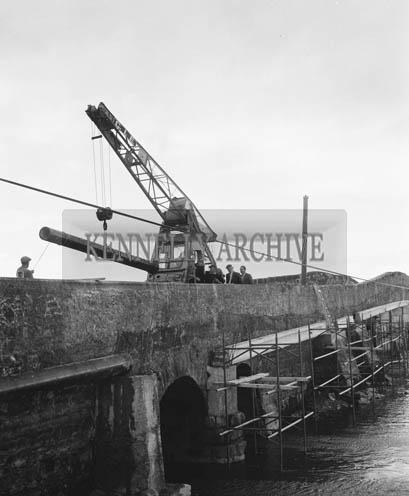 28th April 1964; A photo of water scheme pipes across Blennerville Bridge.