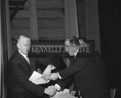 Tuesday 15th December 1964; A CIE Staff Member receives a certificate for completing the Safety First Course in the CYMS, Tralee.