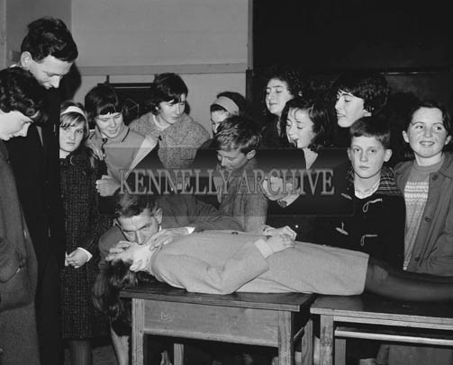 December 1964; John Lovett, Kerry Area Director of the Irish Red Cross, gives a first Aid demonstration at the Red Cross Safety First Lecture in the Technical School in Tralee. The Lecture was delivered by Dr. Theodore Kozlik as part of the Campaign for Road Safety First Aid.