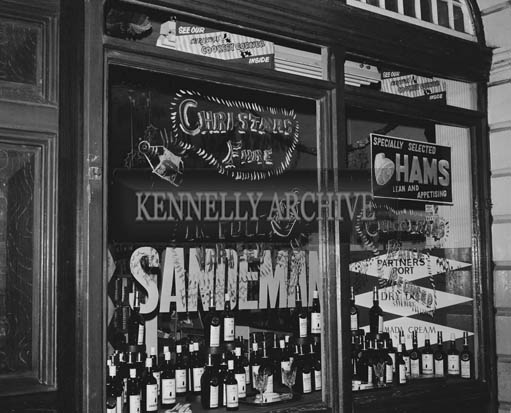 December 1964; A photo of a shop window in Tralee.