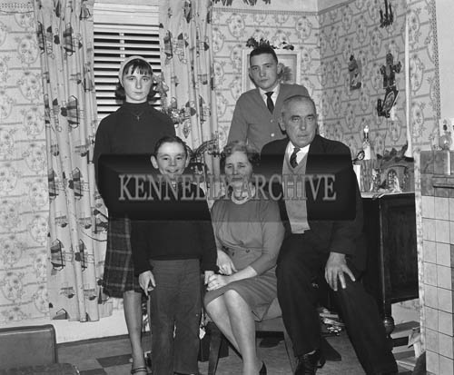 December 1964; A photo of a family in their home at Christmas.