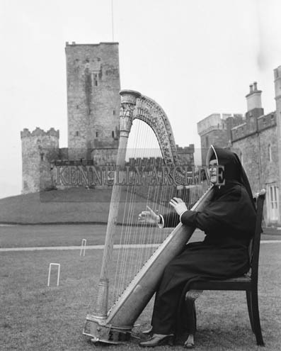 20th February 1966; A nun plays the Padraig Pearse Harp, from his School, St Enda's, which was presented to Drishane Convent, Millstreet.