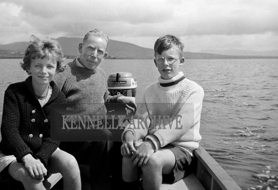 1953; A Photo Of A Man And Two Children On A Boat Trip Off Valentia Island.