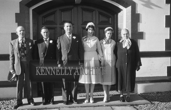 1953; A Wedding Group Posing For The Camera Outside The Royal Hotel On Valentia Island.