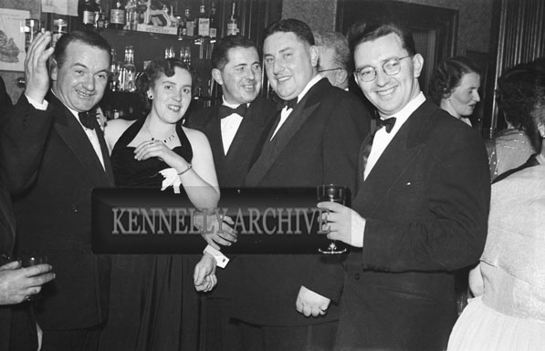 January 1954; A Group Of People Posing At The Golf Dress Dance And Dinner In Killarney .