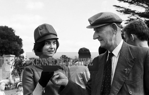 September 1964; Tralee Town Park Gardener Pat Wynne Presenting A Rose To One Of The Contestants For The Rose Of Tralee Festival.