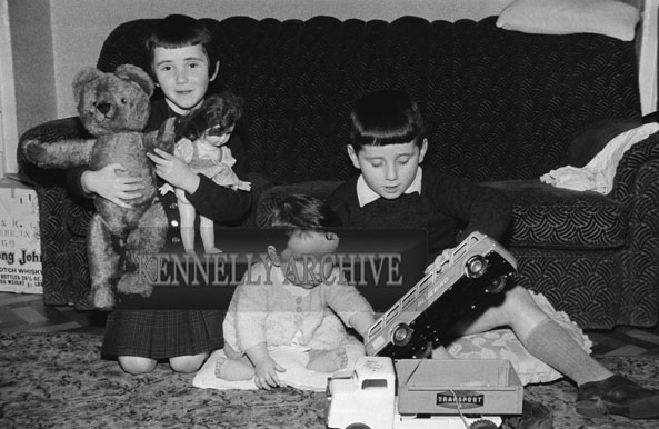 1953; A Photo Of A Family Of Children Playing At Home.