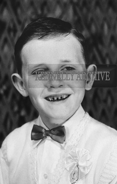 1953; A Studio Photo Of A Communion Boy.